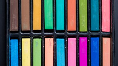 A box containing oil pastels of various colours