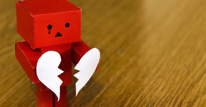 A cardboard box man crying