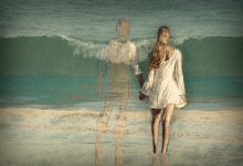 A faded drawing of a couple on the beach