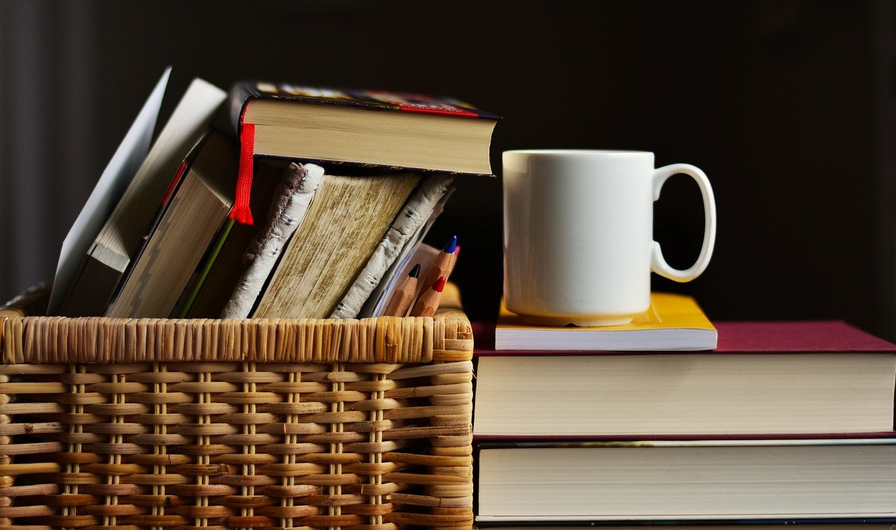 Books in a basket and a coffee