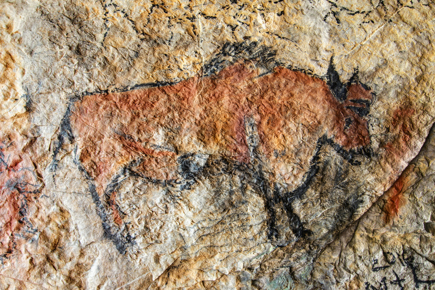 A prehistoric cave painting of a buffalo
