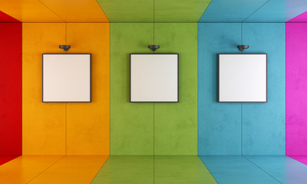Empty painting frames on a colourful wall