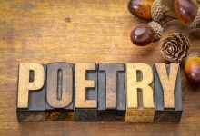 "The word ""poetry"" written in wooden blocks"
