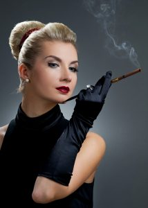 An actress smoking with a cigarette holder