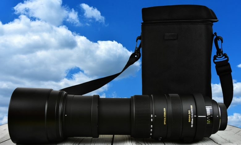 A sigma camera lens with blue sky background