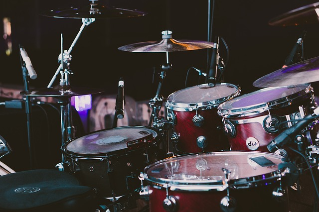 A drum stool behind the set