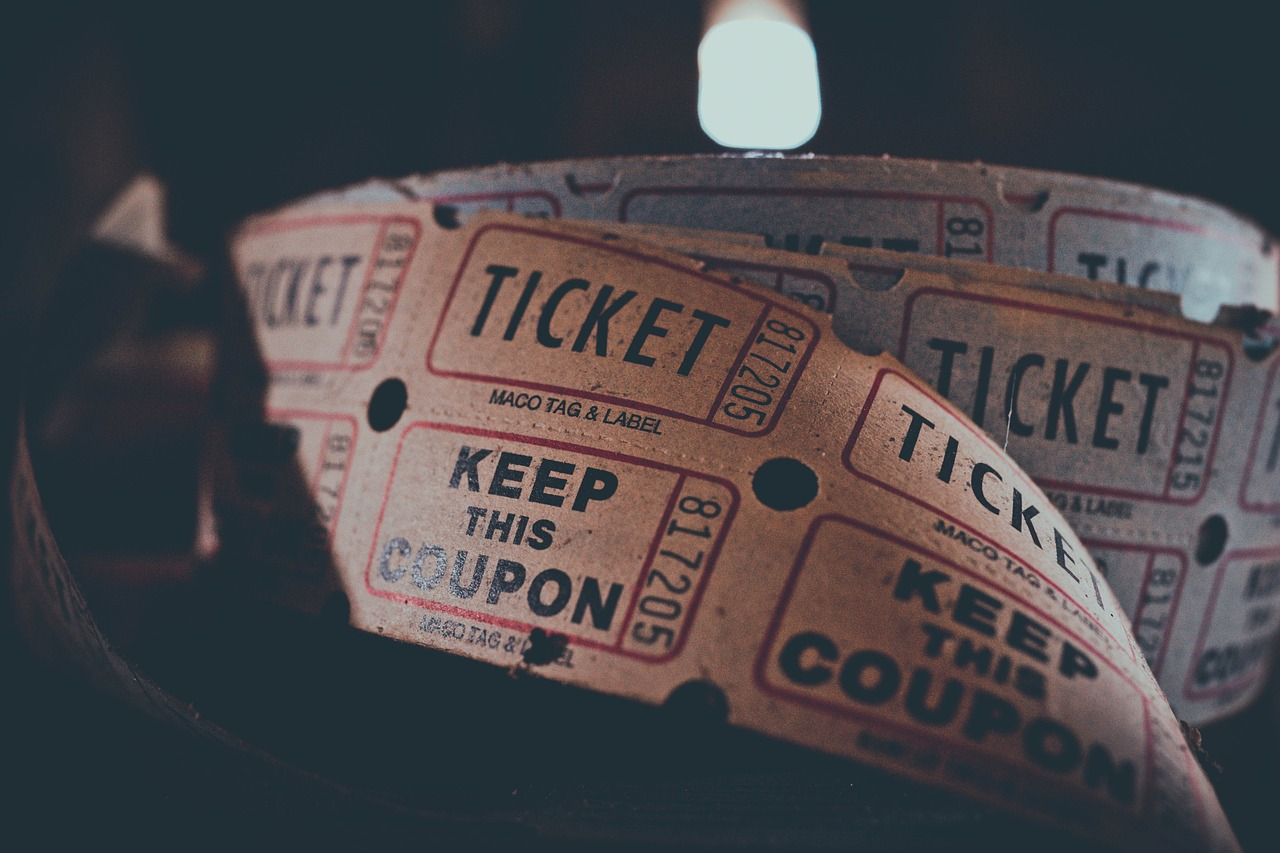 Several old fashioned movie tickets