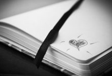 A poetry notebook with a heart drawn on it