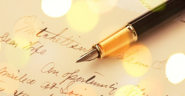 A calligraphy pen with writing on a letter