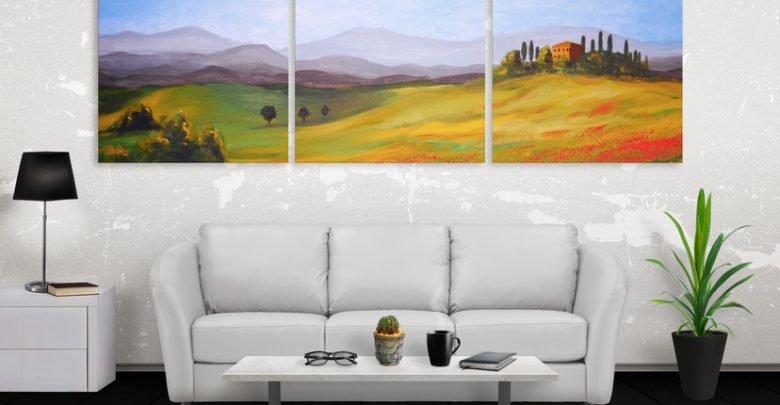 Three connecting art prints of a landscape on a wall