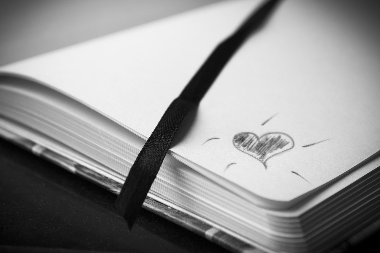 A notepad with a small heart in the corner