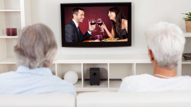 An elderly couple watching TV