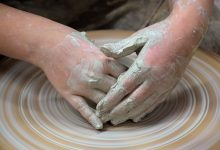 Hand using a pottery wheel
