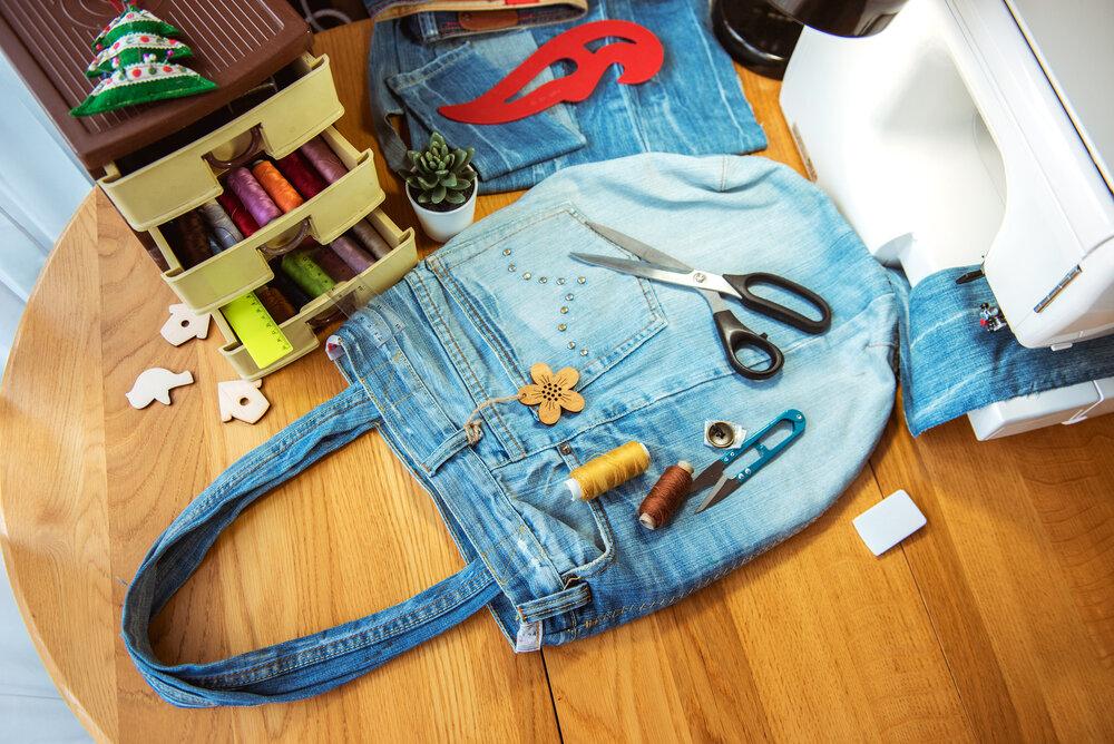 A denim bag next to a sewing machine