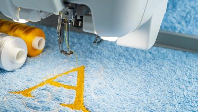 A letter A being sewn onto fabric